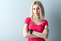 Beautiful young woman making serious expression Stock Photos