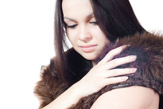 Beautiful young woman with Man-made fur isolated. Beautiful smiling young woman wearing man made fur isolated Stock Photo