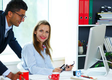 Beautiful young woman and man working from home Royalty Free Stock Photos
