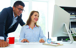 Beautiful young woman and man working from home Stock Image