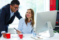 Beautiful young woman and man working from home Stock Photography