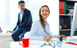 Beautiful young woman and man working from home Royalty Free Stock Image