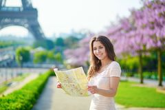 Beautiful young woman with map in Paris Royalty Free Stock Photos
