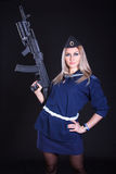 Beautiful young woman in a marine uniform with an assault rifle Royalty Free Stock Photo