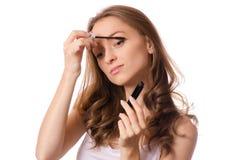 Beautiful young woman mascara Stock Images