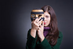 Beautiful young woman with  mask. Royalty Free Stock Photo