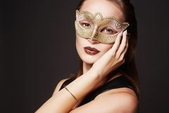 Beautiful young woman in mask. Beauty red haired girl in Carnival Mask Stock Images
