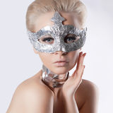 Beautiful young woman in mask Royalty Free Stock Images