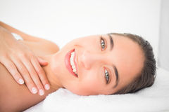 Beautiful young woman on massage table at spa center Royalty Free Stock Photography