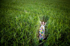 Beautiful young woman in meadow Stock Photos