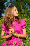 Beautiful young woman in a meadow full of flowers Royalty Free Stock Photos