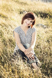 Beautiful young woman in the meadow, female portrait. Beautiful young caucasian woman posing in the summer meadow. female portrait. Vertical composition. Beauty stock photography