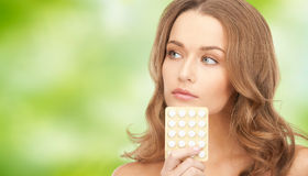 Beautiful young woman with medication Royalty Free Stock Photography