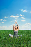 Beautiful young woman meditating at the meadow Royalty Free Stock Photo