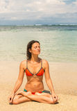Beautiful young woman meditating by the ocean Royalty Free Stock Photography