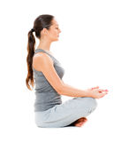 Beautiful young woman is meditation Stock Images