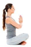 Beautiful young woman is meditation Stock Photos