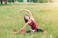 Beautiful young woman during meditation and yoga with a smile looking at the camera royalty free stock photos