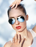 Beautiful young woman in mirrored sunglasses Stock Photo