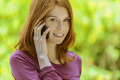 Beautiful young woman with mobile Stock Photos