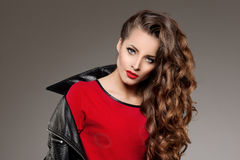Beautiful young woman model brunette with long curled hair with Stock Photo