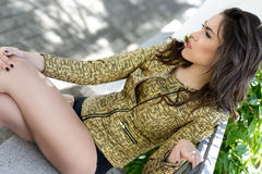 Beautiful young woman, model of fashion, in a garden Royalty Free Stock Images