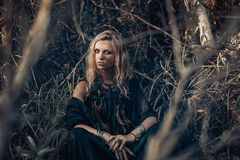 Beautiful young woman model portrait in forest. witchcraft conce. Beautiful young woman model portrait in forest. witchcraft Royalty Free Stock Images
