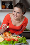 Beautiful young woman in modern kitchen Stock Photos