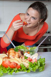 Beautiful young woman in modern kitchen Royalty Free Stock Image