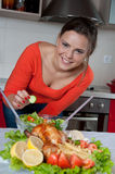 Beautiful young woman in modern kitchen Stock Photography