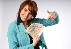 The beautiful young woman with money Royalty Free Stock Images