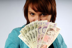 The beautiful young woman with money Stock Photo