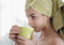 Beautiful young woman with morning cup of hot beverage. Stock Photos