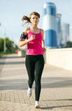 Beautiful young woman on a morning jog in the city Royalty Free Stock Images