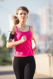 Beautiful young woman on a morning jog in the city Royalty Free Stock Photography