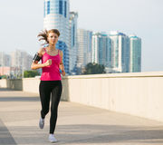 Beautiful young woman on a morning jog in the city Stock Image