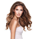 A beautiful young woman with moving long wavy hair Royalty Free Stock Photo