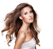 A beautiful young woman with moving long wavy hair Royalty Free Stock Photography