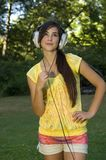 Beautiful young woman with music Royalty Free Stock Photos
