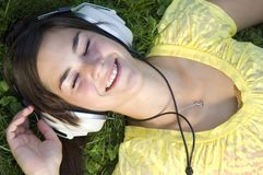 Beautiful young woman with music Royalty Free Stock Photo