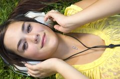 Beautiful young woman with music Stock Photography