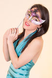 Beautiful young woman with mysterious mask. Royalty Free Stock Photography
