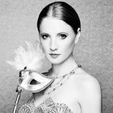 Beautiful young woman in mysterious  Venetian mask Stock Photo