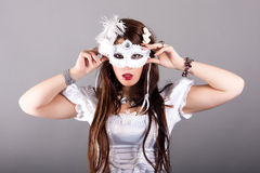 Beautiful young woman with mysterious venetian mask Stock Photos
