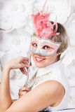 Beautiful young woman in mysterious white mask Royalty Free Stock Photography