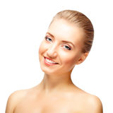 Beautiful young woman with naked shoulders smiles Royalty Free Stock Image