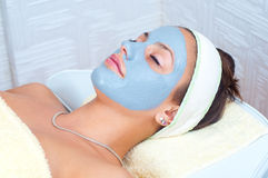 Beautiful young woman with natural facial mask Royalty Free Stock Photo