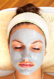 Beautiful young woman with natural facial mask royalty free stock photography