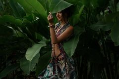 Beautiful young  woman on natural tropical background royalty free stock photography