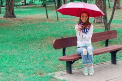 Beautiful young woman on nature benches umbrella Stock Images